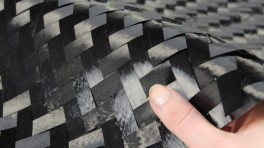 Carbon reinforced wood table tennis blade